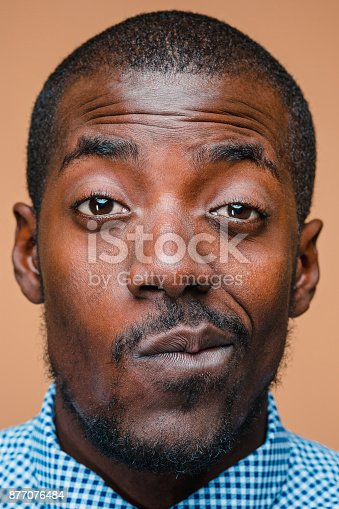 istock Positive thinking African-American man on brown background 877076484