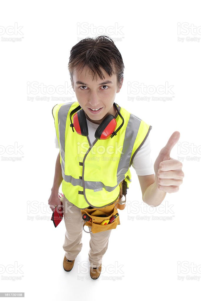 Positive trainee builder laborer thumbs up royalty-free stock photo