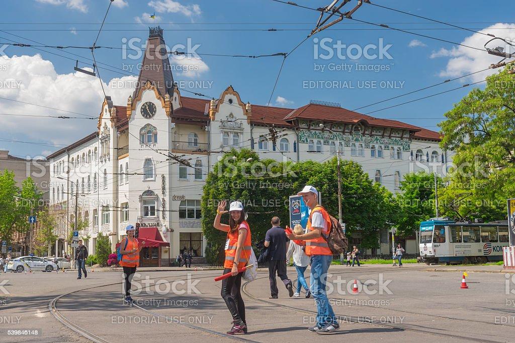 Positive volunteers near hotel Ukraine stock photo