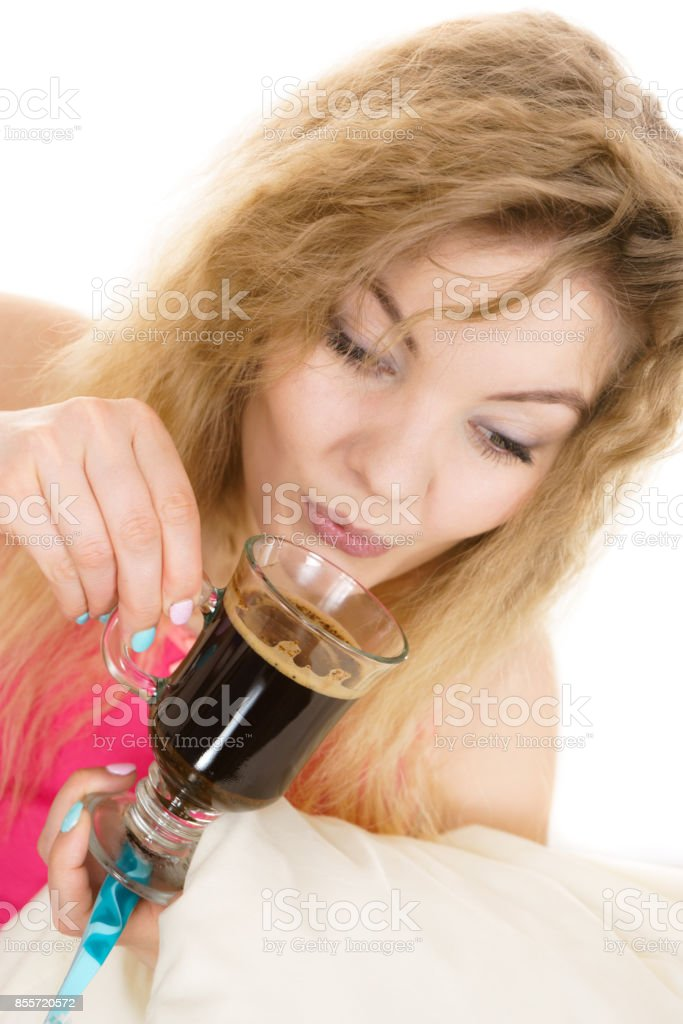 Positive woman drinking her morning coffee stock photo