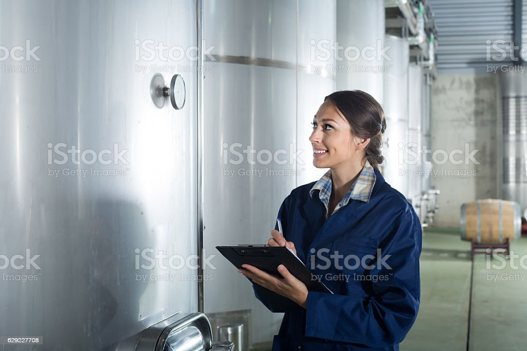 Positive woman standing with cardboard stock photo