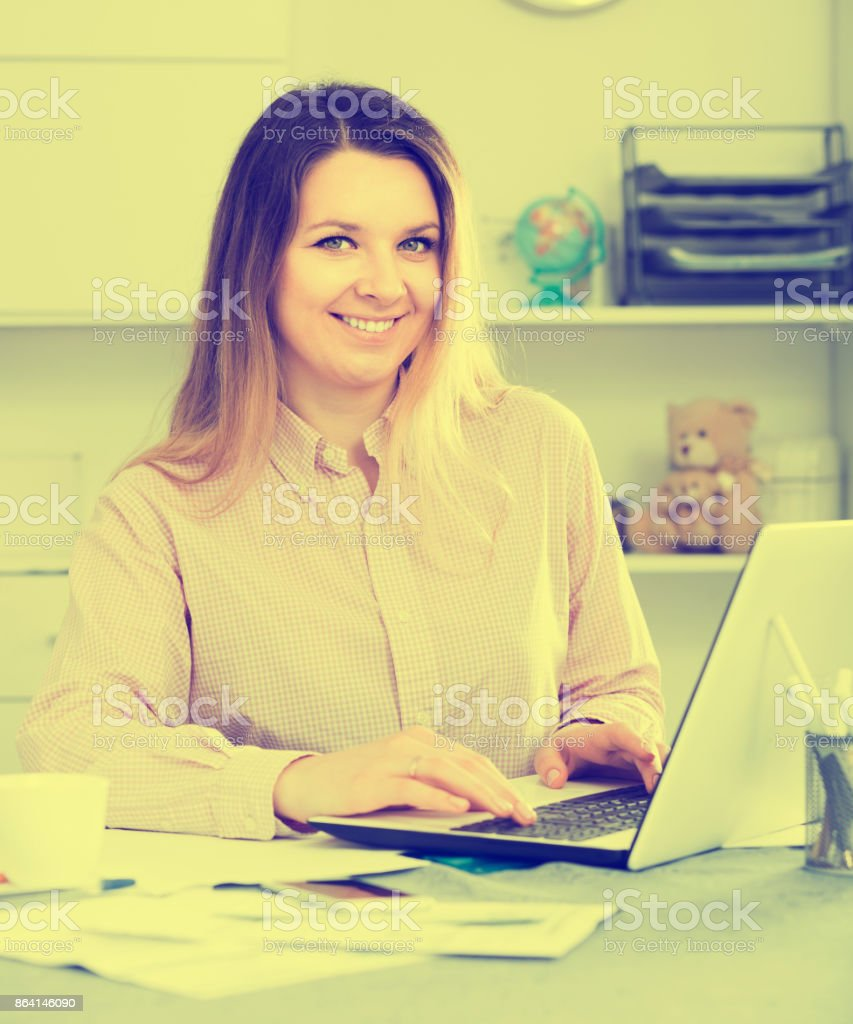 Positive woman worker working effectively in office royalty-free stock photo