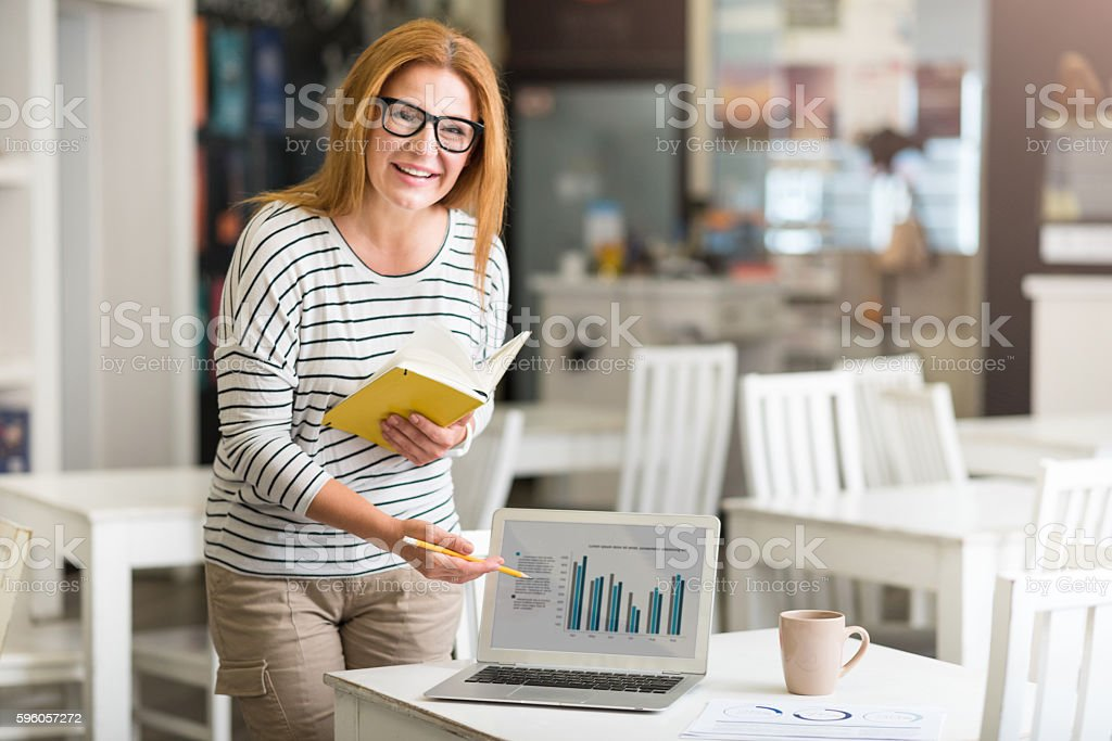 Positive woman working on the project royalty-free stock photo