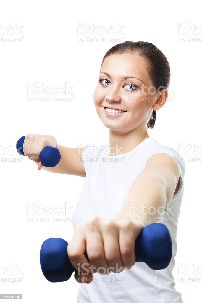 Positive young woman with dumbbells royalty-free stock photo