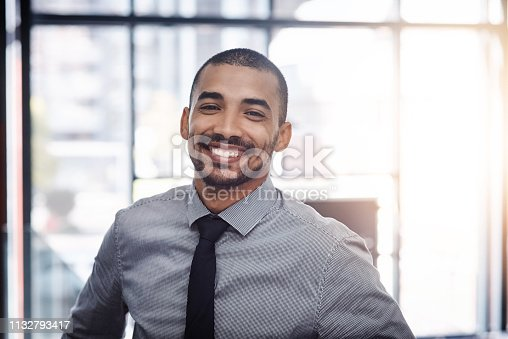 Portrait of a confident young businessman working in a modern office
