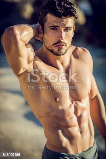 istock posrtrait of a handsome ripped young man 643405456