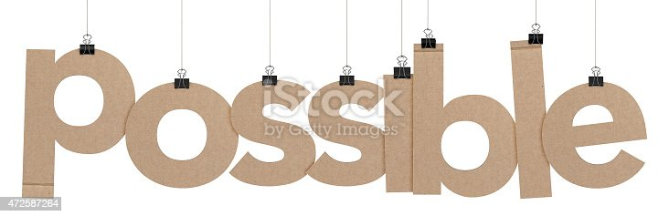 A  3D representation of the word possible hanging on a plain white background. The word is hanging from binder paper clips that are attached to a piece of string. The letters have a cardboard texture. The background is pure white.