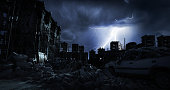 Digitally generated accurate scene of destroyed city/post nuclear city scene with ruined architecture (night).\n\nThe scene was rendered with photorealistic shaders and lighting in Autodesk® 3ds Max 2016 with V-Ray 3.6.