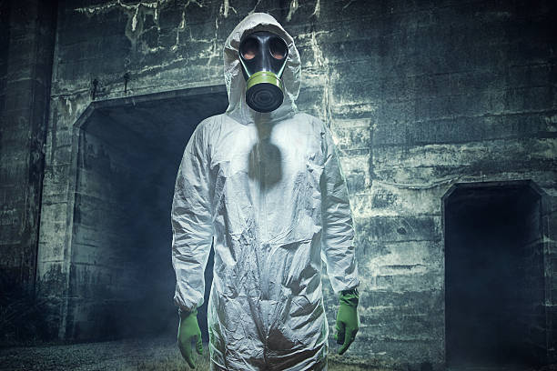 post apocalyptic biological wasteland man - white suit stock photos and pictures