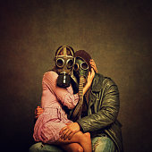 Young post apocalyptic couple hugging each other. Added brown tone, grain, damage, textures and vignetting for the mood.