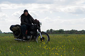 istock A post apocalyptic man on motorcycle in a meadow 967120794