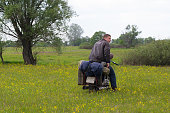 istock A post apocalyptic man on motorcycle in a meadow 967121414
