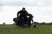 istock A post apocalyptic man on motorcycle in a meadow 967121848
