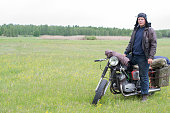 istock A post apocalyptic man on motorcycle in a meadow 967124806