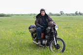 istock A post apocalyptic man on motorcycle in a meadow 967126066