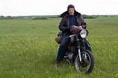 istock A post apocalyptic man on motorcycle in a meadow 967126514