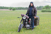 istock A post apocalyptic man on motorcycle in a meadow 967126850