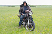 istock A post apocalyptic man on motorcycle in a meadow 967130016