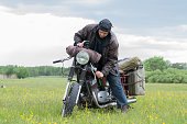 istock A post apocalyptic man on motorcycle in a meadow 967130580
