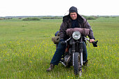 istock A post apocalyptic man on motorcycle in a meadow 967130930