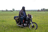 istock A post apocalyptic man on motorcycle in a meadow 967133634