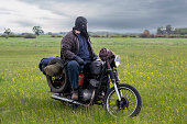 istock A post apocalyptic man on motorcycle in a meadow 981541260