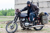 istock A post apocalyptic man on motorcycle near the destroyed building 967121122