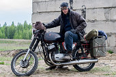 istock A post apocalyptic man on motorcycle near the destroyed building 967121572