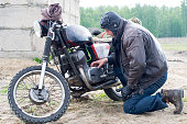 istock A post apocalyptic man on motorcycle near the destroyed building 967122200