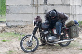 istock A post apocalyptic man on motorcycle near the destroyed building 967129328