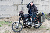 istock A post apocalyptic man on motorcycle near the destroyed building 967130752