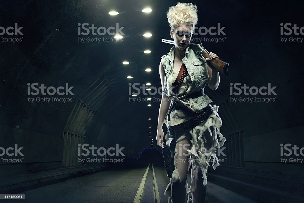 Post Apocalyptic Woman in Dark Tunnel royalty-free stock photo