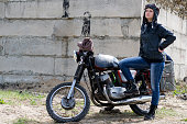 istock A post apocalyptic woman near motorcycle near the destroyed building 967120618