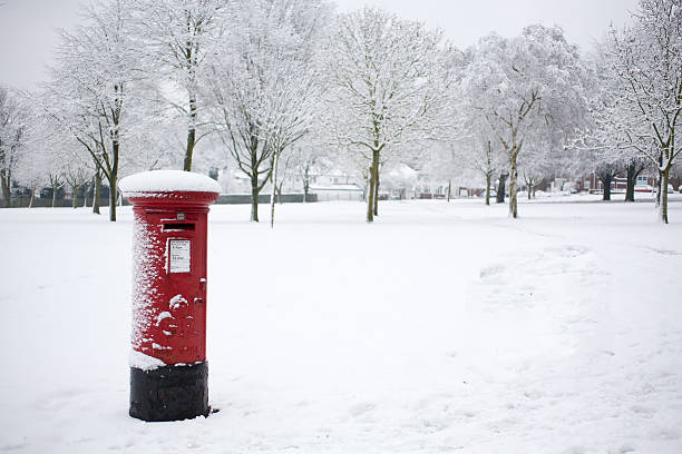 Post box in the snow stock photo