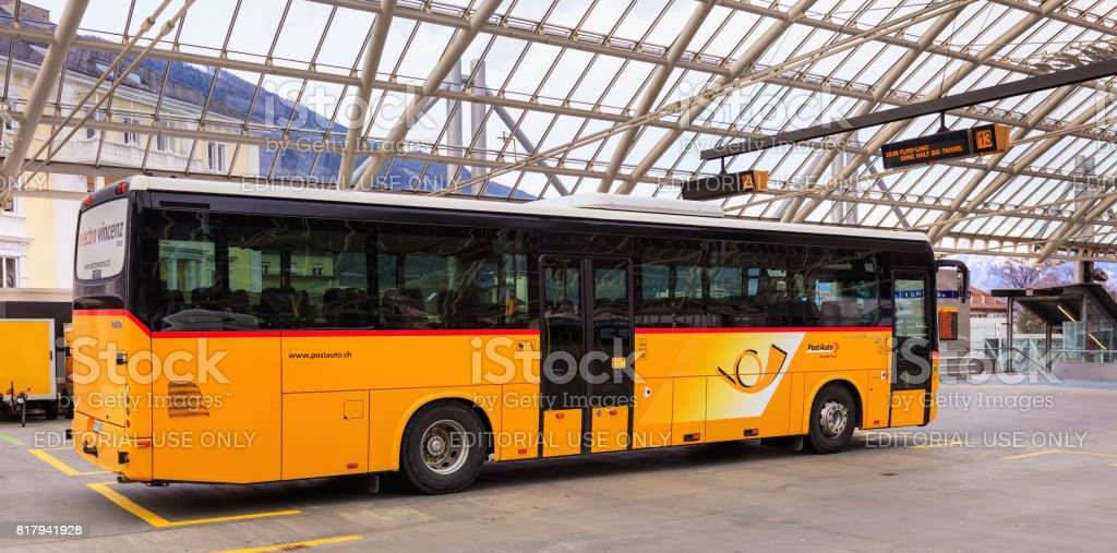 Post Bus at the bus station in the city of Chur, Switzerland stock photo