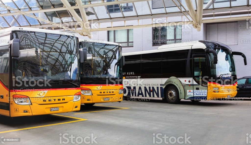 Post Buses at the bus station in the city of Chur in Switzerland stock photo