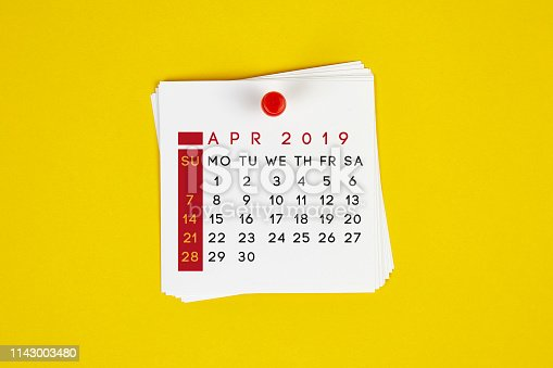 1124594277 istock photo Post It April 2019 Calendar On Yellow Background 1143003480