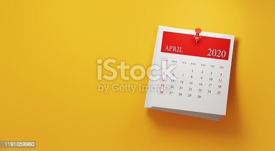 2020 post it April calendar on yellow background. Panoramic composition with copy space. Calendar and reminder concept.
