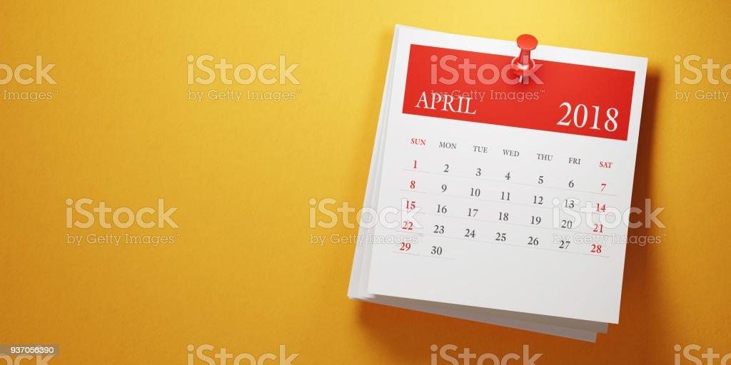 Publicar calendario April sobre fondo amarillo - foto de stock
