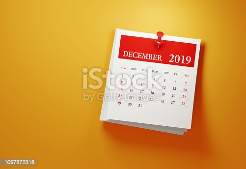 Post it December 2019 calendar on yellow background. Horizontal composition with copy space. Calendar and reminder concept.