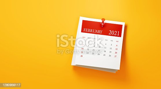 2021 post it February calendar on yellow background. Horizontal composition with copy space. Calendar and reminder concept.