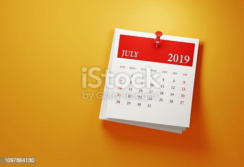Post it July 2019 calendar on yellow background. Horizontal composition with copy space. Calendar and reminder concept.