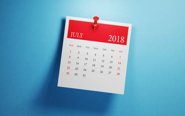 post it july calendar on blue background - july stock photos and pictures