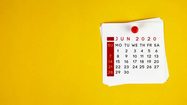 Post It June 2020 Calendar On Yellow Background stock photo