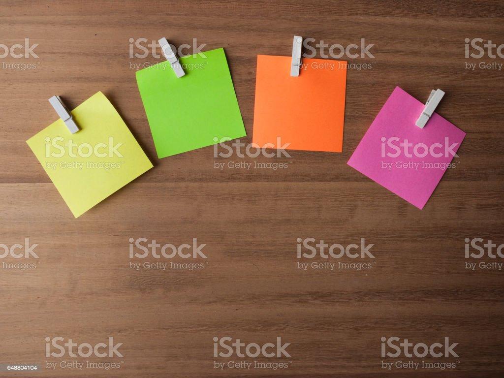 Post It Notes on Pegs On Light Wood stock photo