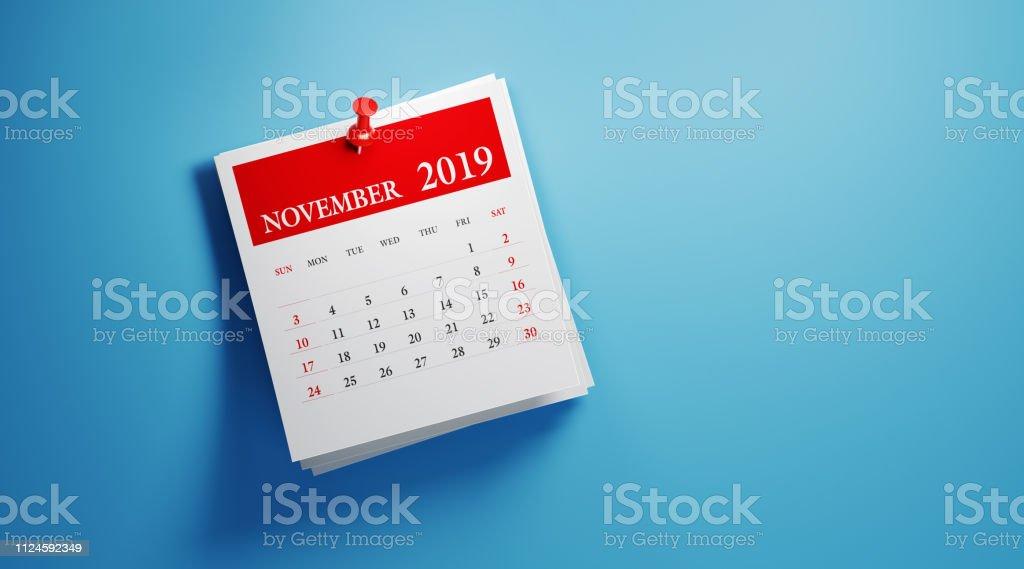在藍色背景下發布2019年11月日曆 - 免版稅2019圖庫照片