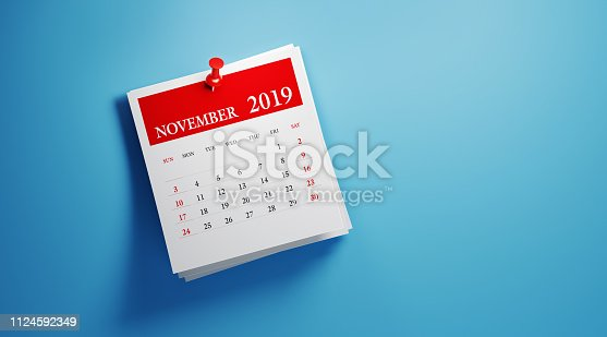 Post it November 2019 calendar on blue background. Horizontal composition with copy space. Calendar and reminder concept.