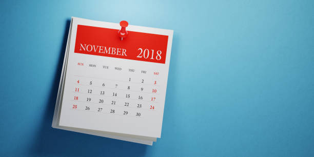 Post It November Calendar On Blue Background stock photo