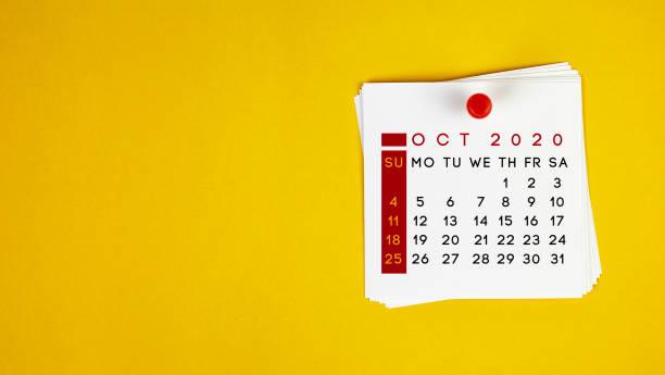 Post It October 2020 Calendar On Yellow Background stock photo