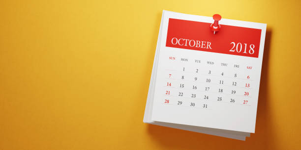 Post It October Calendar On Yellow Background stock photo